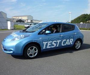 A Nissan Leaf shows off its automated steering parking technology at the Japanese automaker's test ground in Yokohama, Oct. 12, 2012. The vehicle turned on its own and backed into a charging station.