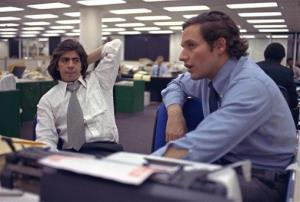 In this May 7, 1973, photo, reporters Bob Woodward, right, and Carl Bernstein sit in the newsroom of the Washington Post in Washington.