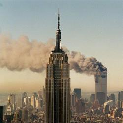 In this Sept. 11, 2001, photo, the twin towers of the World Trade Center burn behind the Empire State Building in New York.
