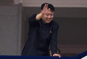 In this July 27, 2013, photo, North Korean leader Kim Jong Un waves to Korean War veterans.