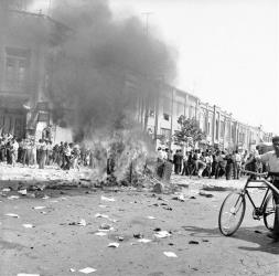 In this 1953 file photo, office equipment of a Communist newspaper is burned in a Tehran street.