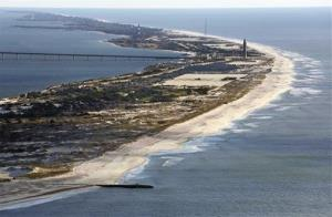 FILE - This aerial file photo shows Robert Moses State Park on Fire island, after Superstorm Sandy struck, damaging many oceanfront communities.