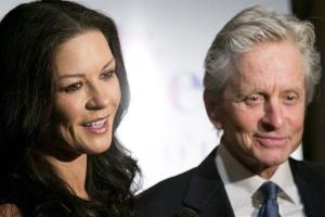 Honoree Michael Douglas and his wife Catherine Zeta-Jones attend the Eugene O'Neill Theater Center's 12th Annual Monte Cristo Awards in New York, Monday, April 16, 2012.