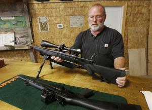 Jim Sowash handles a rifle at his gun shop near Stover, Mo.. Sowash signed a letter to Missouri Gov. Jay Nixon urging him to sign a bill nullifying federal gun laws. Nixon vetoed the measure, but an override looks likely.