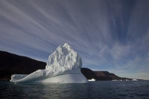 In this July 21, 2011 file  photo, an iceberg floats in the sea near Qeqertarsuaq, Disko Island, Greenland.