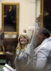 In this June 26, 2013, file photo Sen. Wendy Davis celebrates as time runs out on an abortion bill in Austin, Texas.