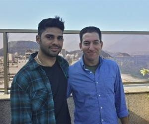 In this undated photo provided by Janine Gibson of the Guardian, Guardian journalist Glenn Greenwald, right, and partner David Miranda are shown together at an unknown location.