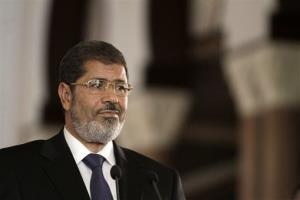 In this July 13, 2012 file photo, Egyptian President Mohammed Morsi holds a news conference.
