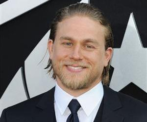 Charlie Hunnam has been cast as Christian Grey, according to author EL James.