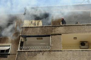 In this photo released by the Syrian official news agency SANA, Syrians firefighters try to extinguish a fire after a missile hit a residential building in Damascus, Syria, Monday, Sept. 2, 2013.