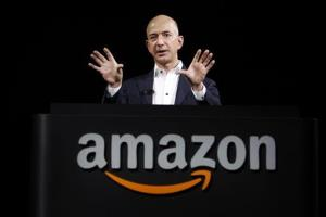 In this Sept. 6, 2012, file photo, Jeff Bezos, CEO and founder of Amazon, speaks at the introduction of the new Amazon Kindle Fire HD and Kindle Paperwhite personal devices, in Santa Monica, Calif.