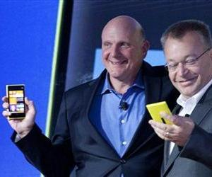 Steve Ballmer, left, chairman and CEO of Microsoft, and Stephen Elop, CEO of Nokia, introduce Nokia's newest smartphone, the Lumia 920, equipped with Windows Phone 8, on Sept. 5.