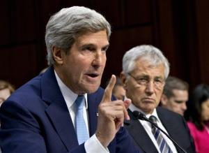 Secretary of State John Kerry testifies on Capitol Hill as defense chief Chuck Hagel listens.