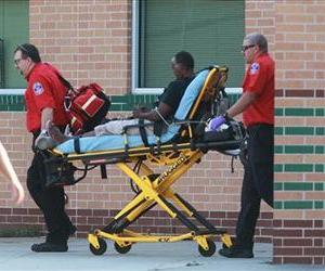 Emergency personnel remove a person from the school after at least one person was killed and others were injured during an altercation inside Spring High School, Sept. 4, 2013, in Spring, Texas.