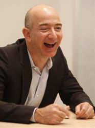Amazon CEO Jeff Bezos laughs during an interview Tuesday, Oct. 6, 2009, in Cupertino, Calif.