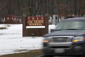 In this Jan. 12, 2010 file photo a vehicle passes Jim Thorpe's tomb, left, in Jim Thorpe, Pa.