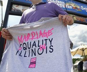 In this Aug. 14, 2013 file photo, Randy Hannig of Equality Illinois, hands out shirts supporting gay marriage at the Illinois State Fair in Springfield, Ill.