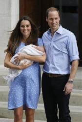 In this July 23, 2013 photo, Britain's Prince William and Kate, Duchess of Cambridge, pose with the Prince of Cambridge outside St. Mary's Hospital in London.