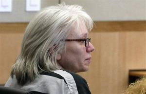 In this Aug. 1, 2013, photo, Debra Milke listens to a judge in court.