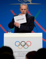 IOC President Jacques Rogge shows the name of the city of Tokyo elected to host the 2020 Summer Olympics.