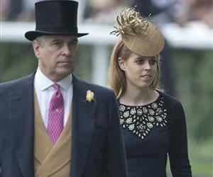 Britain's Prince Andrew and daughter Princess Beatrice walk at the Royal Ascot horse race meeting in Ascot, England, Thursday, June 20, 2013.