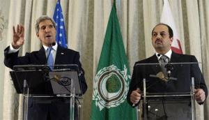 Secretary of State John Kerry answers a question during a news conference with Qatar Foreign Minister Khalid Al Attiya, right, at the US Embassy in Paris, Sunday, Sept. 8, 2013.