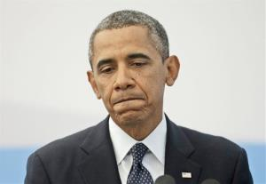 US President Barack Obama pauses as he answers a question regarding the ongoing situation in Syria.
