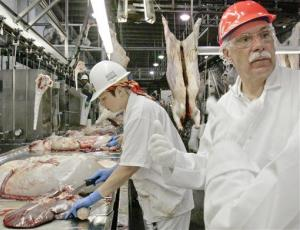 Agriculture Secretary Ed Schafer, right, follows the work of USDA inspectors at the Cargill meat packing plant in Schuyler, Neb., Tuesday, July 8, 2008.