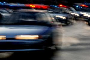 An inmate fled after stabbing a police officer in Detroit.
