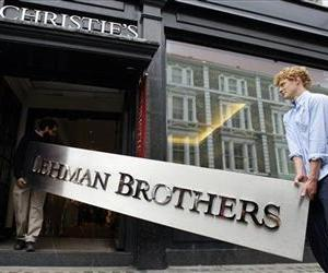 The Lehman Brothers corporate sign in polished metal is taken into an auction house in London, Sept. 24, 2010.