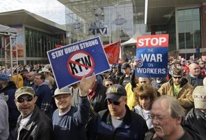 Union workers protest through the Super Bowl Village following a right-to-work vote by legislatures at the Statehouse Wednesday, Feb. 1, 2012, in Indianapolis.