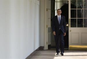 President Obama walks along the West Wing Colonnade toward the Oval Office Tuesday.