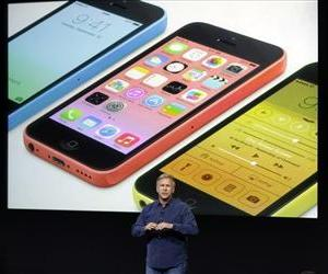 Phil Schiller, Apple's senior vice president of worldwide product marketing, speaks on stage during the introduction of the new iPhone 5c in Cupertino, Calif., Sept. 10, 2013.