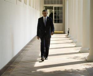 President Obama walks along the West Wing Colonnade toward the Oval Office Tuesday, ahead of his daily briefing.