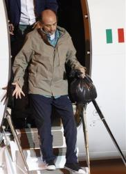 Italian journalist Domenico Quirico arrives home to Italy.