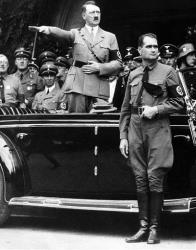 This Dec. 30 1938 file photo shows German Chancellor Adolf Hitler and his personal representative Rudolf Hess, right, during a parade in Berlin, Germany.