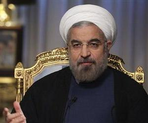 Iranian President Hasan Rouhani speaks during an interview with state television at the presidency in Tehran, Iran, Sept. 10, 2013.