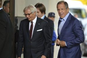 Russian Foreign Minister Sergei Lavrov, right, arrives for the Geneva meeting.