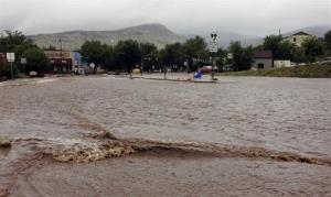 This image provided by Jason Stillman, shows flooding in Lyons Colo., Thursday Sept. 12, 2013.