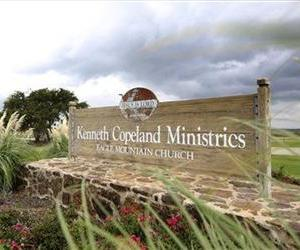 A sign stands outside Kenneth Copeland Ministries Eagle Mountain Church.  The Texas megachurch is linked to at least 21 cases of measles and has been  hosting vaccination clinics in response.