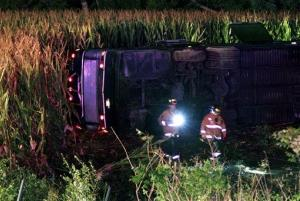 Officials work the scene of an overturned Greyhound bus on interstate I-75 in Liberty Township, Ohio.