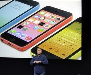 Phil Schiller, Apple's senior vice president of worldwide product marketing, speaks on stage during the introduction of the new iPhone 5c in Cupertino.