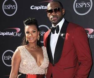 Miami Heat's LeBron James, right, and Savannah Brinson arrive at the ESPY Awards on Wednesday, July 17, 2013, in Los Angeles.