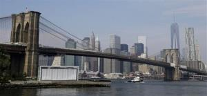 The Brooklyn Bridge stretches in front of the Manhattan skyline in New York, Thursday, Sept. 12, 2013.