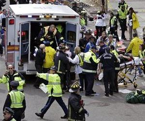 In this April 15, 2013 file photo, medical workers aid injured people after two bombs exploded near the finish line of the Boston Marathon.