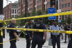 Police work the scene on M Street, SE in Washington near the Washington Navy Yard.