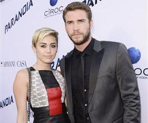 Actor Liam Hemsworth and singer and actress Miley Cyrus arrive on the red carpet at the US premiere of the feature film Paranoia at the DGA Theatre on Thursday, Aug. 8, 2013 in Los Angeles.