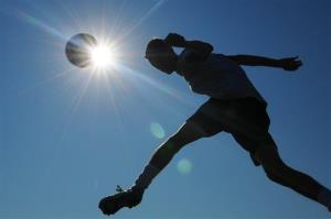 A member of a high school soccer team works out for conditioning training in Salina, Kansas.