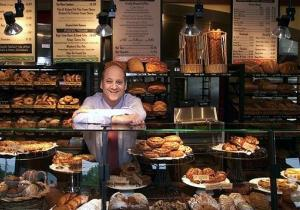 In this May, 2002 file photo Panera Bread Co. CEO Ron Shaich stands behind a counter in a St. Louis cafe.