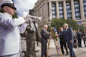 Defense Secretary Chuck Hagel, right, and Joint Chiefs Chairman Gen. Martin Dempsey, second from right, present a wreath at the Navy Memorial to remember the victims of Monday's shooting.